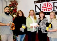 WVNCC presents items collected and a check to the Youth Services System Freeze Shelter. (L to R) Matt Badillo, WVNCC student and SCARSI Club member, Dara Whitemn, WVNCC student and SCARSI Club member, Tammy Krause, director of development, Youth Services System Freeze Shelter, Joyce Britt, faculty advisor SCARI CLUB, Misty Pullen, WVNCC student and SCARSI Club member.