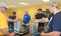 A technical trainer from Pittsburgh Valve & Fitting Co. recently provided hands-on classroom training to Petroleum Technology students at West Virginia Northern Community College. From left are Keith Carroll, Jimmy Blake, Technical Trainer Mike Gagel, Kody White and Gage Francis.