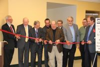 Ribbon-cutting ceremonies are held on the Weirton campus of West Virginia Northern Community College formally opening the $2.78 millionclassroom expansion project which began last May. From left are Weirton Campus Dean Mike Koon, who also is WVNCC's vice president of workforce development; Chancellor James Skidmore of the Community and Technical College System of West Virginia; WVNCC President Martin J. Olshinsky; Brooke County Del. Phil Diserio; Hancock County Del. Randy Swartzmiller; Victor Greco of SMG Architects; Hancock County Del. Ronnie Jones; Weirton Councilman Fred Marsh; and Weirton Mayor George Kondik.