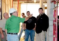West Virginia Northern Community College Program Director Joseph M. Remias, at left, oversees a tour of the construction site of the college's Applied Technology Center in downtown Wheeling. Remias and James Baller, WVNCC director of facilities, second from left, led a group of nine students on an informational field trip as part of their course work in Refrigeration, Air Conditioning and Heating Technology, Industrial Maintenance Technology and/or Appliance Repair. Students shown, from left, are Justin C. Caprita, Mark L. Latimer and Thomas R. Leach.