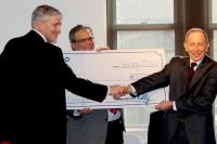 JP Morgan Chase & Co. officials display an oversized check representing $51,000 the firm has provided for scholarships to the Middle College High School Program at West Virginia Northern Community College. The check presentation occurred Tuesday during a media conference at the college. From left are Brad Blair, vice president and business banker at Chase in Wheeling; Stephen S. Bohach, Chase vice president, relationship manager II for Wheeling-Steubenville, and Dr. Martin J. Olshinsky, president of WVNCC.