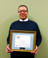 "Darryl Clausell, coordinator, Continuing and Community Education at West Virginia Northern Community College, holds the Presidential Volunteer Service Award from President Barack Obama he received for being designated a ""Drum Major for Service."" Clausell was nominated for the honors by Youth Services System Inc. of Wheeling."