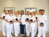 Tammy Aftanas, nursing instructor on the Weirton campus of West Virginia Northern Community College, has received a grant to provide mini iPads to 10 of her students for the current fall semester. From left are Melissa Boyuk, Amy Wiley, Erica Cline, Alexis Carte, Samantha Wells, Aftanas, Heather Molyneaux, Angel Zajac, Tracey King, Angelia Rhodes and Carl Hensley.