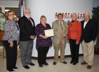 From left, WVNCC Office Administrator Debbie Bennett, WVNCC Dean Larry Tackett, WLU student Janice Hall, WLU Dean Thomas Michaud and donors Carol and Terry Wallace gather at the scholarship presentation.
