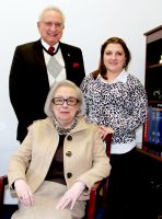 Dr. Mary Marockie, seated, will be honored by West Virginia Northern Community College at its annual fund-raising dinner March 15 at the college. Standing, from left, are Nick Zervos, president of the board of the Wheeling campus Friends of the College, and Rana Spurlock, the college's fund raising and development assistant.