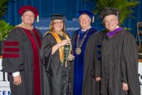"Debbie Bennett, second from left, was named Mountain State University Center Township's ""Student of the Year"" during commencement ceremonies last week. From left are Dr. Timothy Glaid, lead leadership faculty at MSU Center Township; Bennett; Dr. Richard E. Sours, interim president of MSU; and Mark Ciccarelli, J.D., executive director of the Center Township campus."