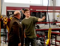 Patrick Marshall, a student in the Mechatronics class being conducted on the Weirton campus of West Virginia Northern Community College, points out some of the state-of-the-art Mechatronics lab equipment to Hancock County Del. Randy Swartzmiller. Mechatronics is a new program that preparesstudents to be electrical and industrial maintenance technicians and is part of the newly-opened addition at the campus.